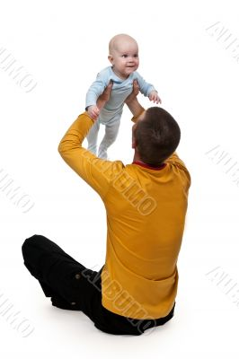 Dad tosses baby