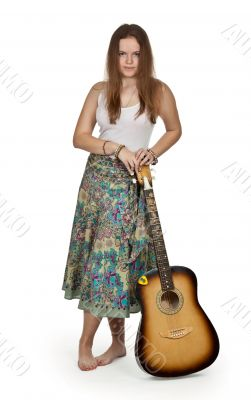girl stands with acoustic guitar