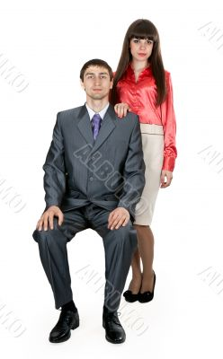 married couple in business attire in the studio