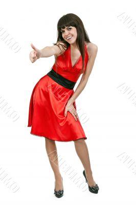 brunette girl in red dress shows OK