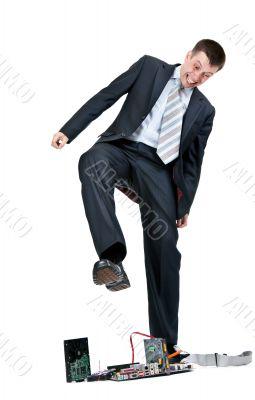 Businessman trampling foot motherboard