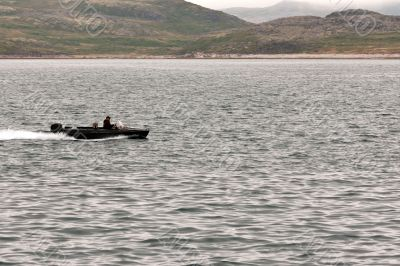 Motor boat rides around the bay in the Barents Sea.