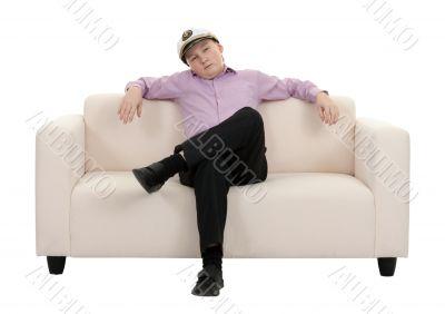 Serious young boy wearing a cap captain