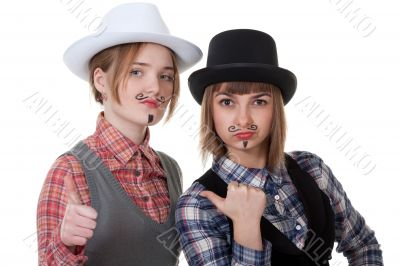 Two girls with painted mustaches