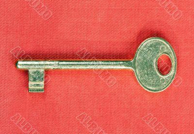 old golden key to the door