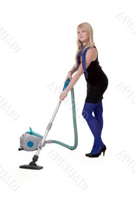 The girl in blue tights with a vacuum cleaner