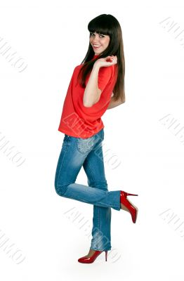 girl in red clothes and blue jeans in the studio