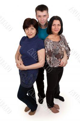 man hugging two women