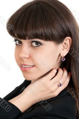portrait of a beautiful brunette girl with jewels
