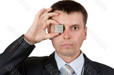 Businessman closes one eye, a processor