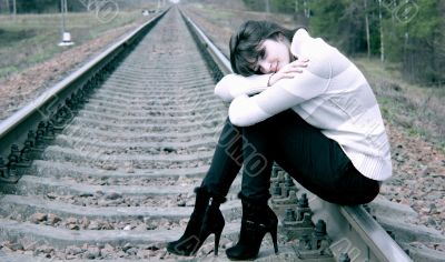 Young woman sitting on the rail