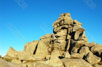Huge rocks against blue sky