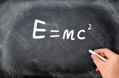 Relativity formula written on a  Blackboard background