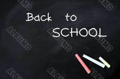 Back to school - text on a blackboard with chalk
