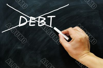Debt being crossed out on a blackboard