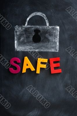 A Lock drawn in chalk with the word Safe