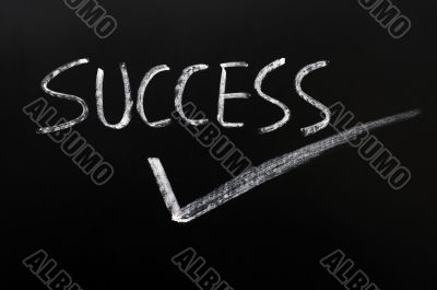 Word of success with a tick