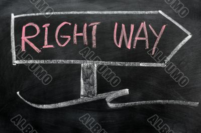 Signpost of right way drawn in chalk on a blackboard