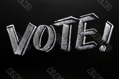 Vote word written on a blackboard