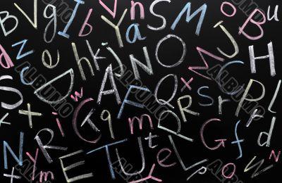 Random letters on a blackboard