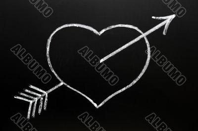 Heart with Cupid`s arrow hitting through