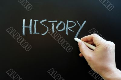 Writing the word history on a blackboard