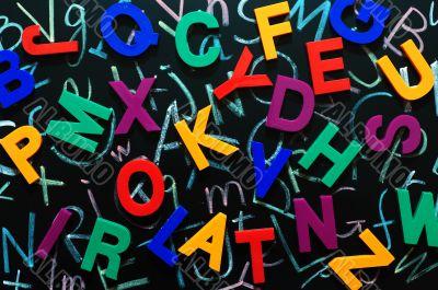 Colorful random letters on a blackboard