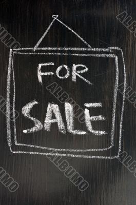 For sale - text written on blackboard