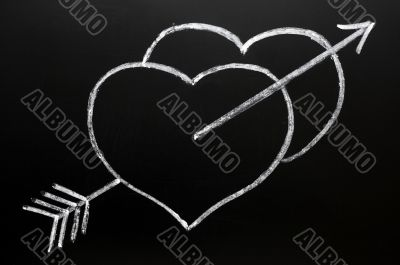 Two hearts with Cupid`s arrow hitting through