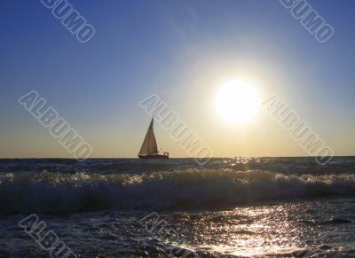 Lonely sail drifting by the sea summertime