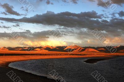 Landscape of Tibetan lakes at sunset