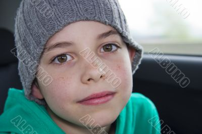 closeup of cute young teen boy in gray hat
