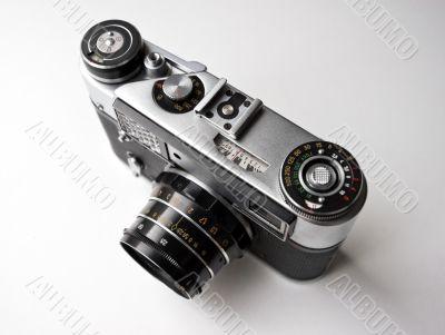 Vintage photo camera on white background