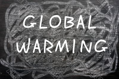 `Global Warming` written on a chalkboard