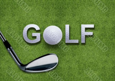Golf ball and putter on green grass