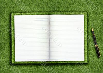 Blank book on grass