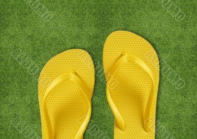 Yellow Flip Flops on green grass