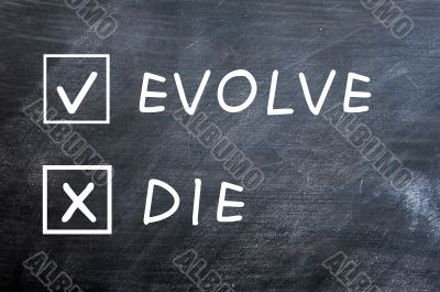 Evolve or die check boxes on a smudged blackboard