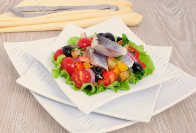 Appetizer of herring and vegetables with croutons