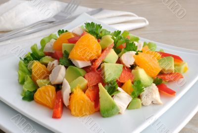 Chicken salad with avocado, sweet pepper and orange