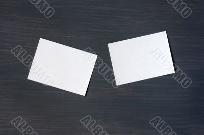 Blank stick note on a blackboard