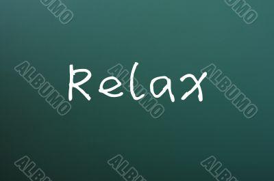 Relax - word written on a blackboard