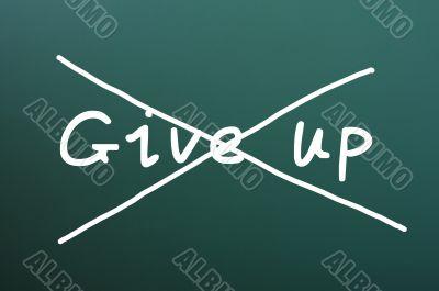 Do not give up, words written on blackboard
