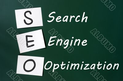 Acronym of SEO - Search engine optimization written on a blackboard