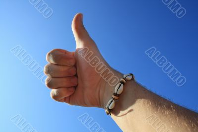 male hand thumbs up