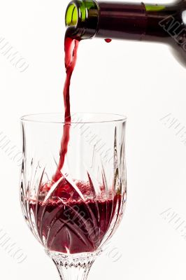 Pouring Red wind into a crystal glass