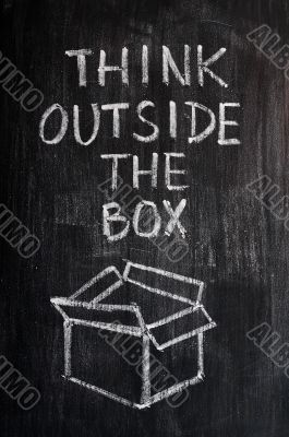 Concept of `Think Outside the box` drawn with chalk on a blackboard