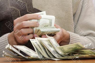 Cash dollars in hands
