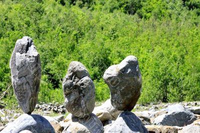 Balanced stones near the caucasus mountain river