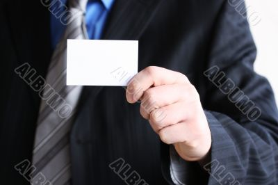Successful businessman holding empty card